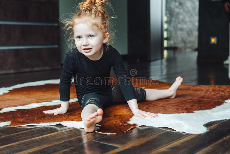 Little girl performs a twine royalty free stock photography