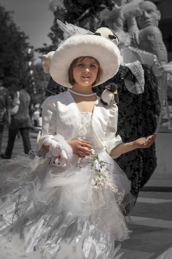 Little girl in period costume in Venice. Black and white, color on the little girl. stock image