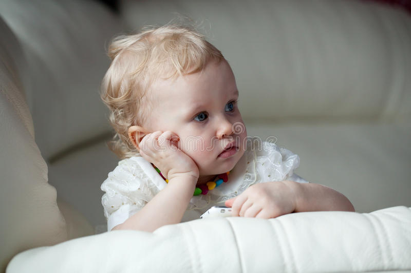 Little Girl With A Phone In Thought Settled Royalty Free Stock Photography