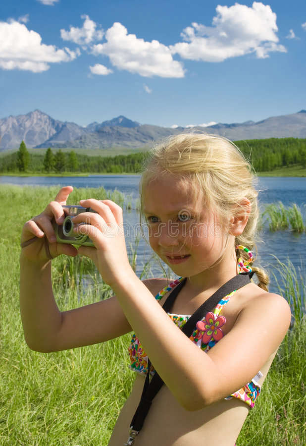 Little girl photographer with camera in Summer stock images