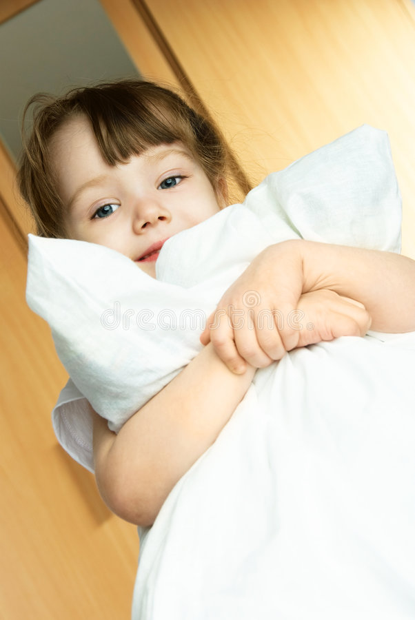 Little girl with a pillow royalty free stock image