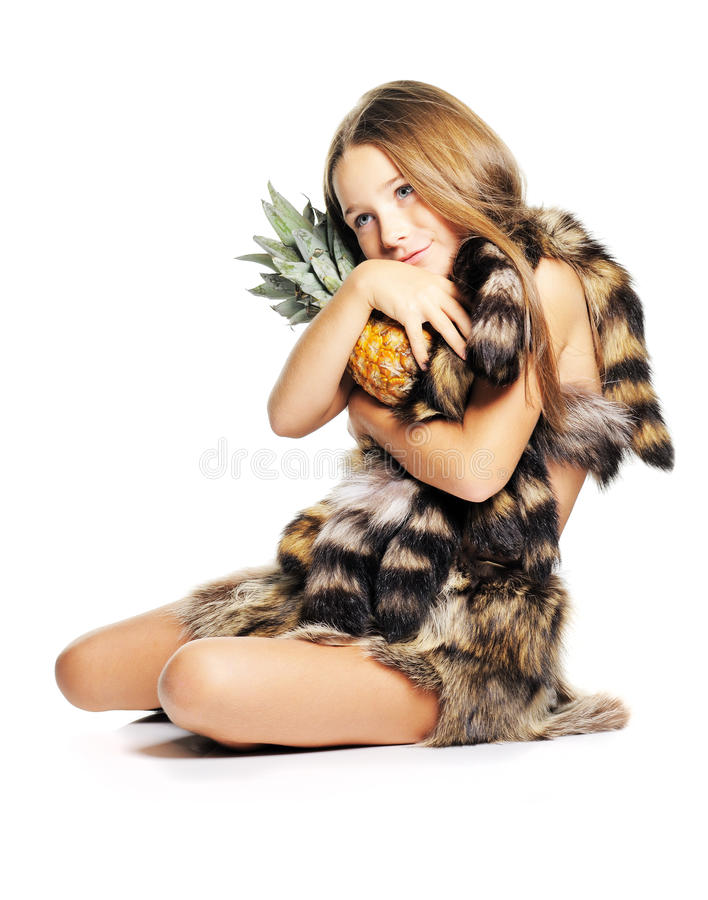 Little girl with pineapple. Little girl posing with pineapple dressed as prehistoric stock photography