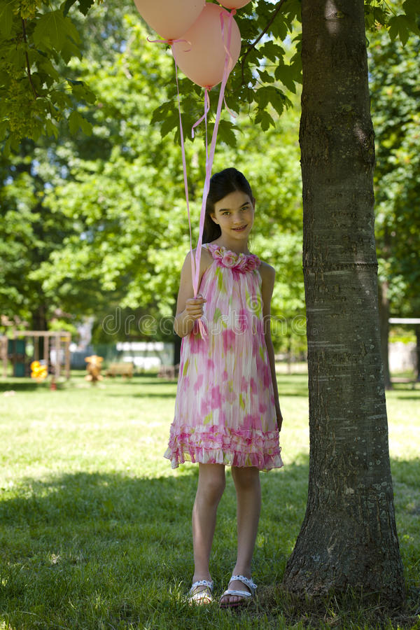 Download Little Girl With Pink Balllons Royalty Free Stock Photos - Image: 26216608
