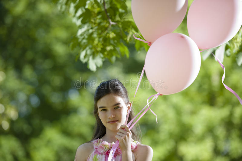 Download Little Girl With Pink Balllons Stock Image - Image: 26216965