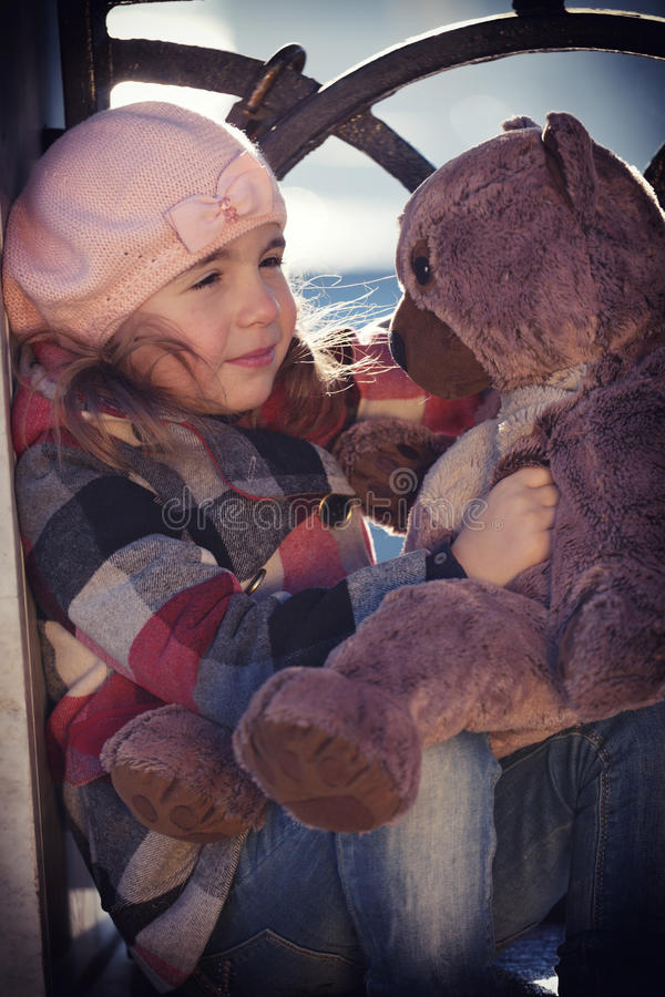 Little girl in a pink beret sits royalty free stock photography