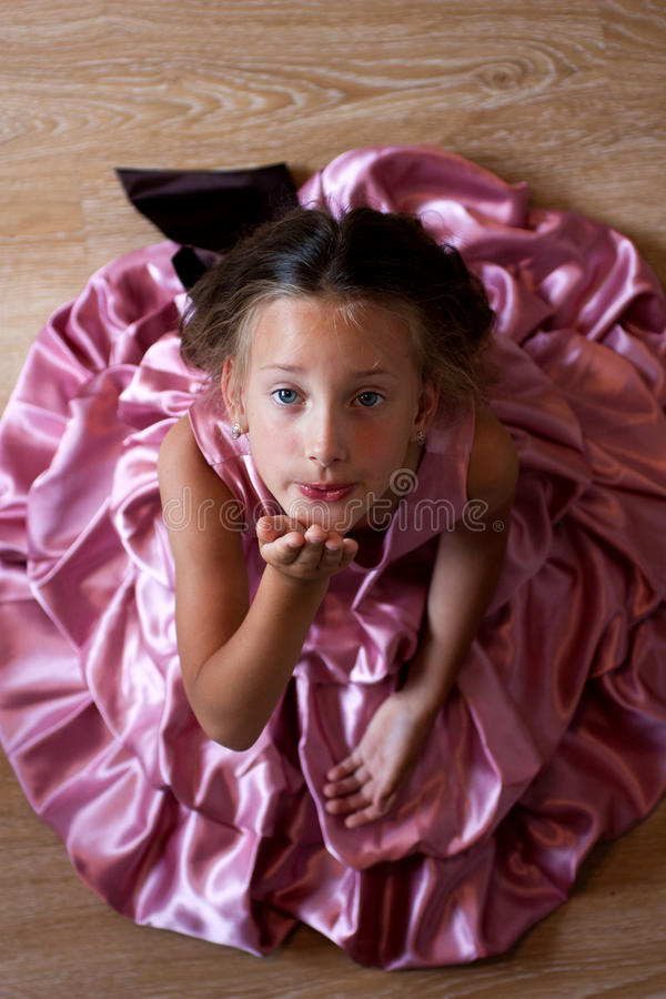 Little girl in a pink dress. Smiling cute little girl in a pink dress festive stock photography