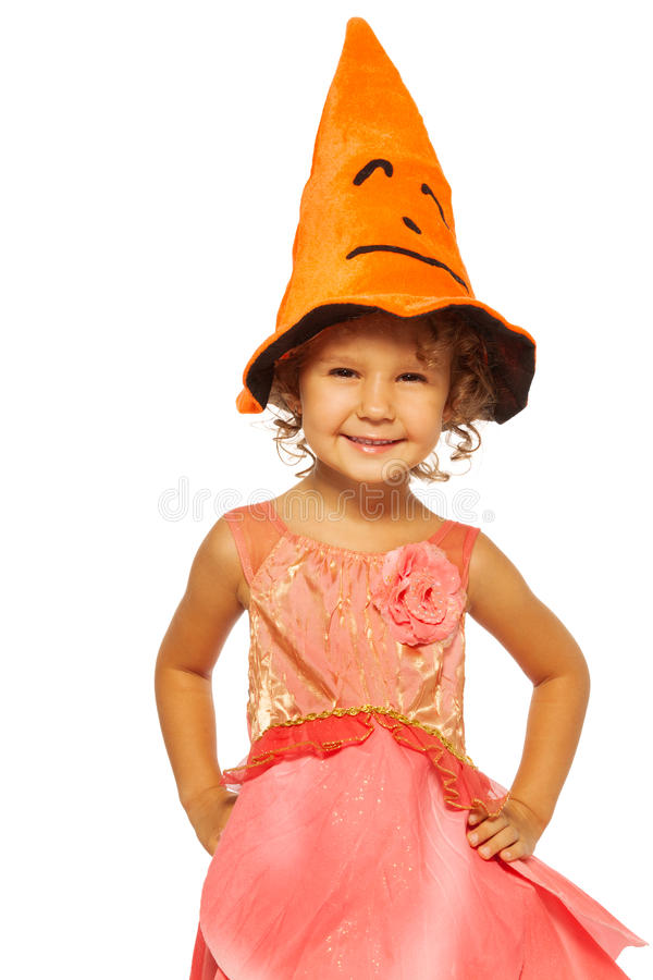 Little girl in pink dress, and Halloween hat stock photography