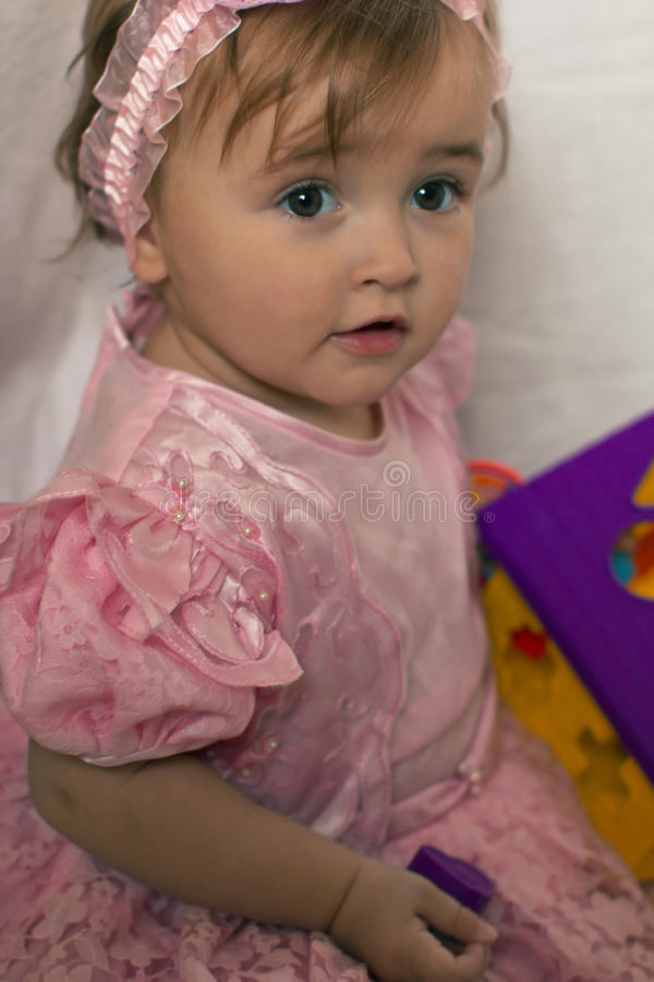 Little girl in a pink dress stock photos