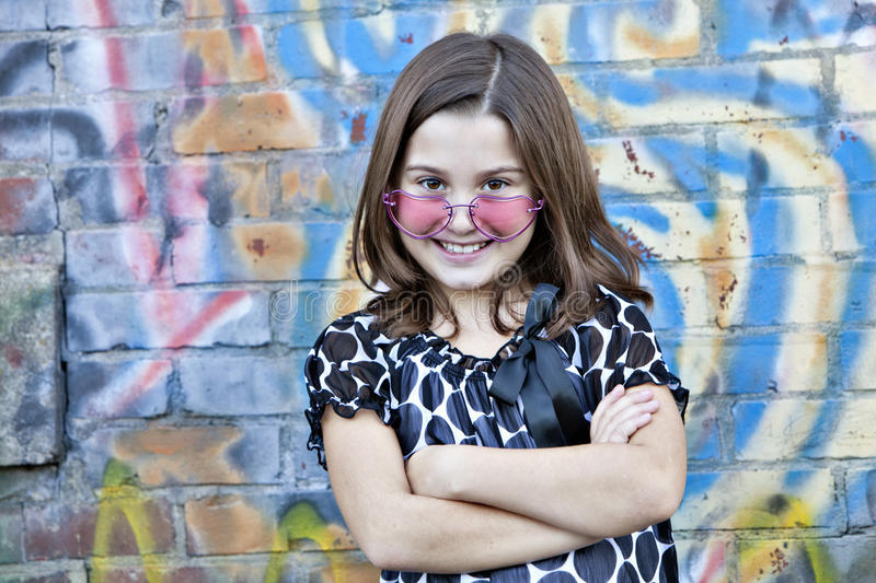 Little girl in pink glasses royalty free stock photography