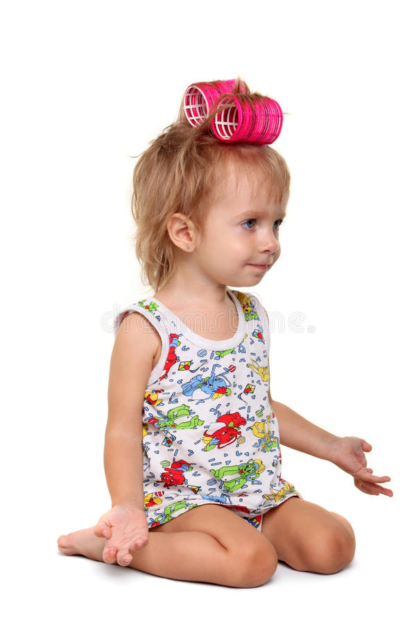 Little Girl With Pink Hair Curlers On Her Head Stock Photography
