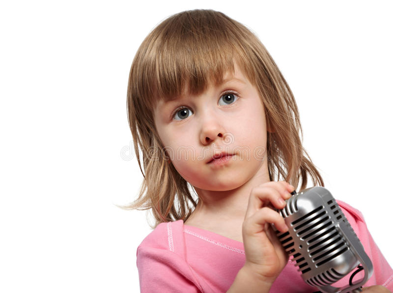 Little girl in pink with microphone. stock photo