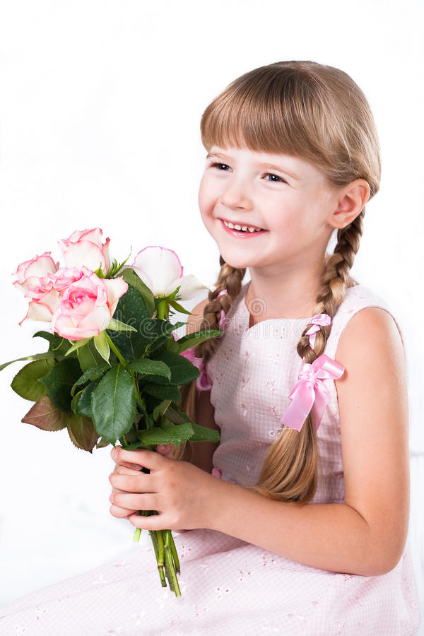 Little girl with pink roses isolated on white stock photography