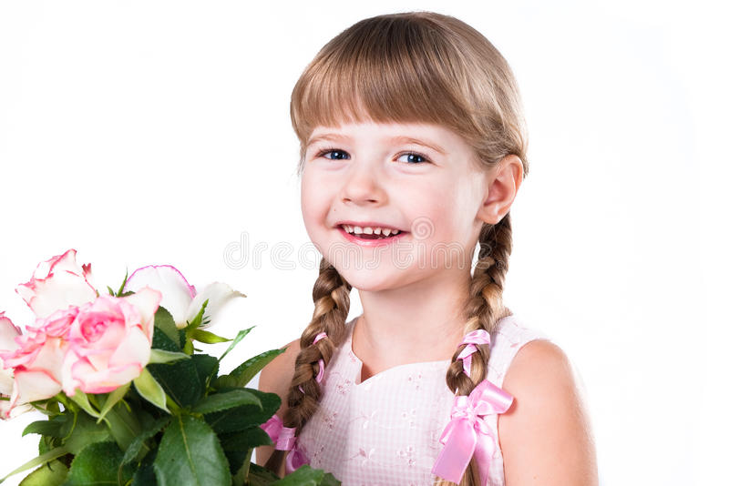 Little girl with pink roses isolated on white stock images