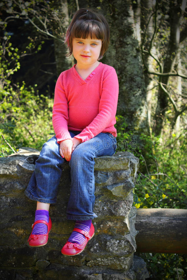 Download Little girl in pink shoes stock image. Image of tree - 24550435