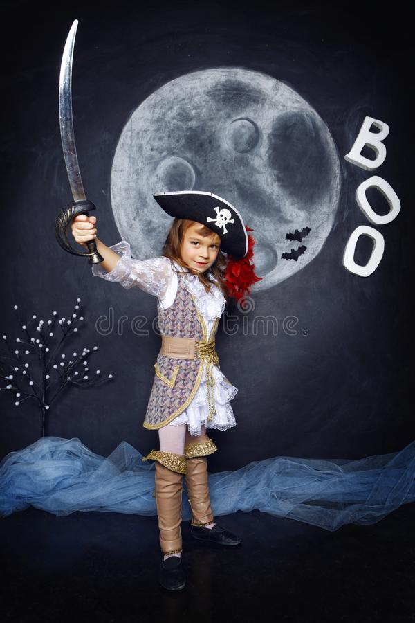 Little girl in pirate costume. Halloween Concept stock images