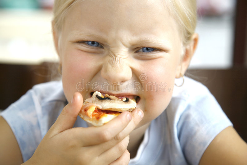 Little girl and pizza stock images