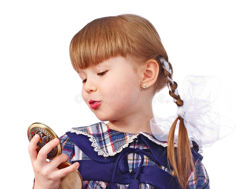 Little Girl With Plaits Kisses Itself In Mirror Royalty Free Stock Image