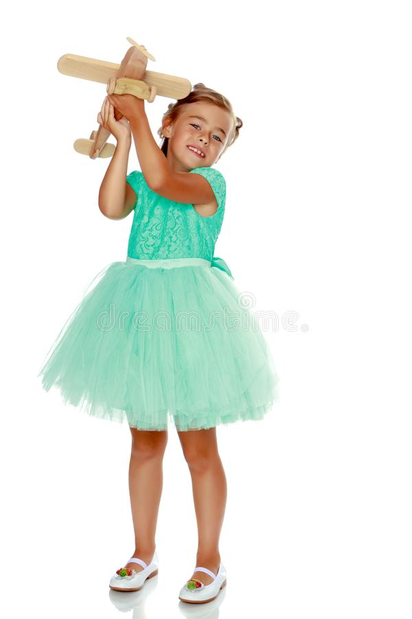 Little girl with a plane in her hand. royalty free stock photo