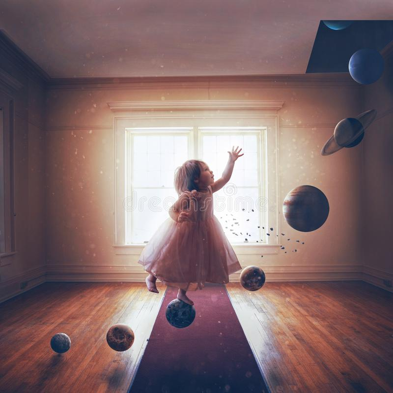 Little girl and the planets. A little girl steps on the planets of the solar system royalty free stock image