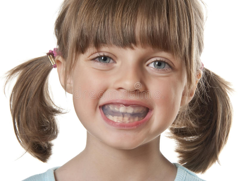 Little girl with plastic braces royalty free stock photos