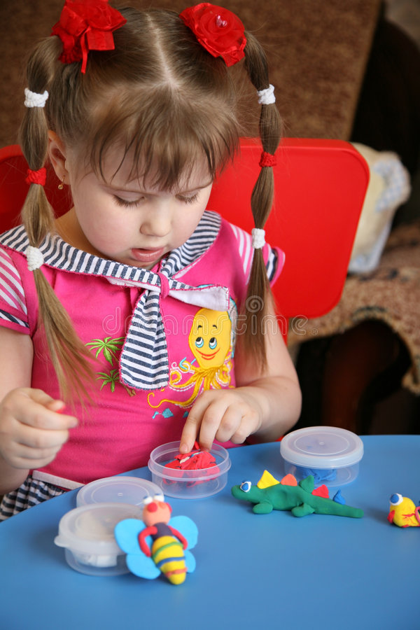 Little girl and plasticine royalty free stock photos