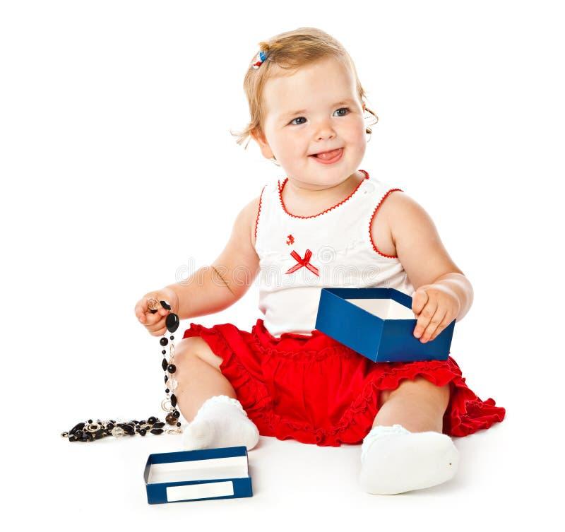 Little girl play on a floor