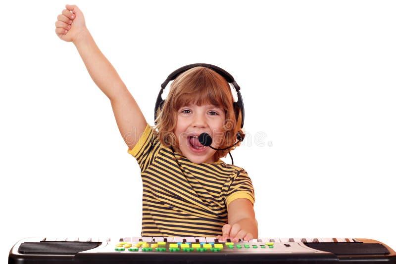 Little girl play keyboard