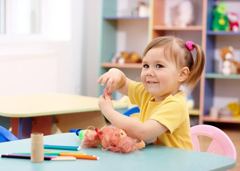 Little girl play in preschool royalty free stock photo