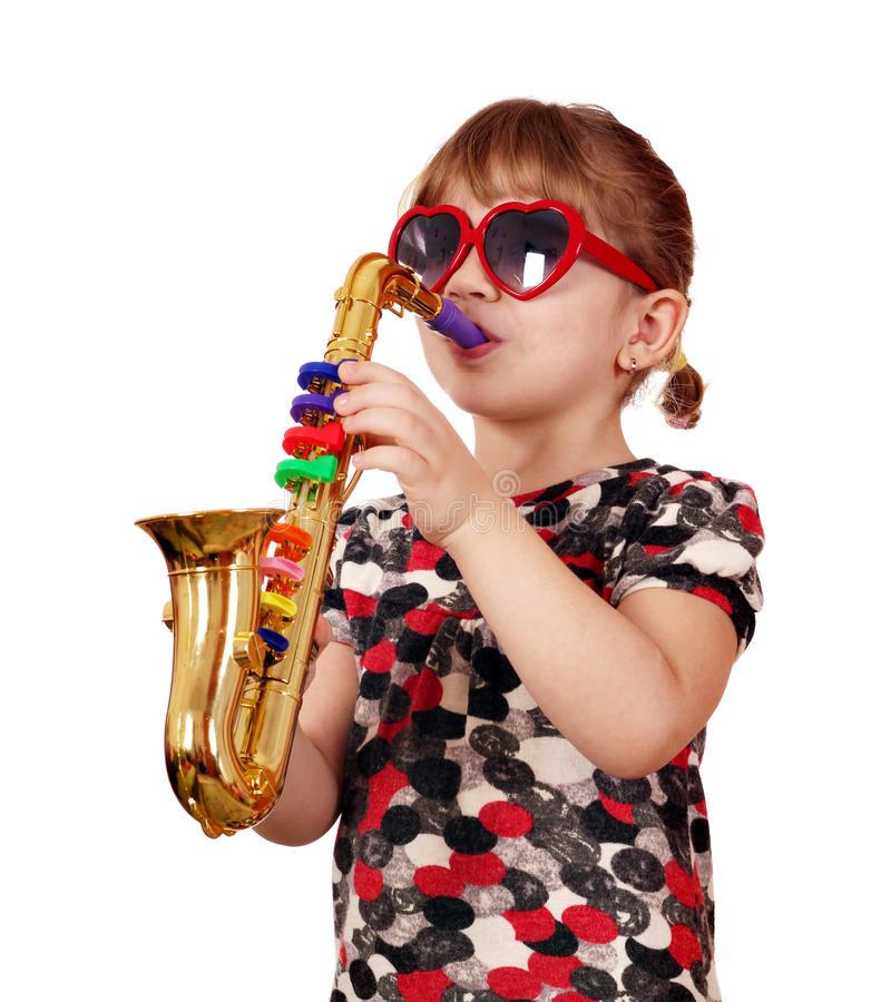 Download Little girl play saxophone stock photo. Image of musician - 26586162