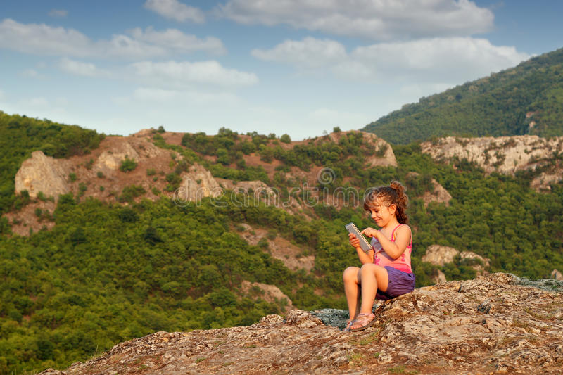 Download Little Girl Play With Tablet Stock Image - Image: 26167753