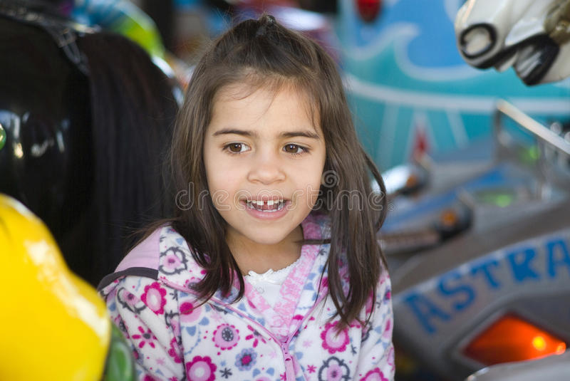 Little girl at playground royalty free stock photo