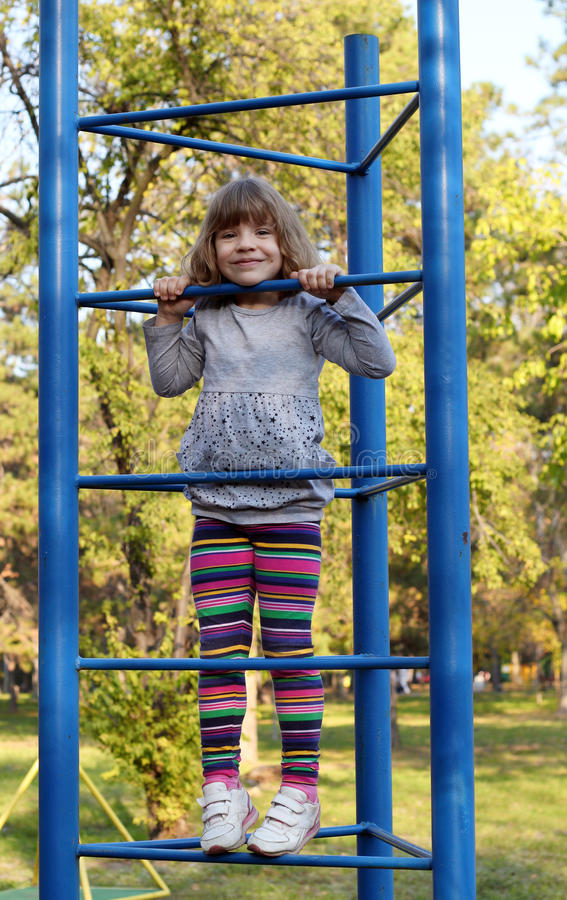 Download Little girl on playground stock image. Image of female - 27436283