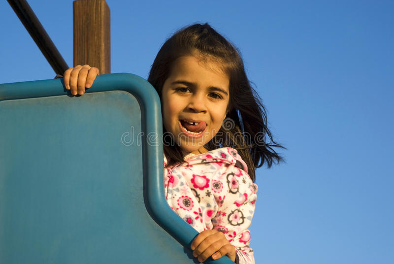 Little girl at playground royalty free stock images