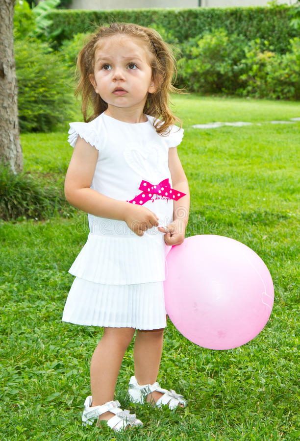 Little girl playing. With balloon stock photos