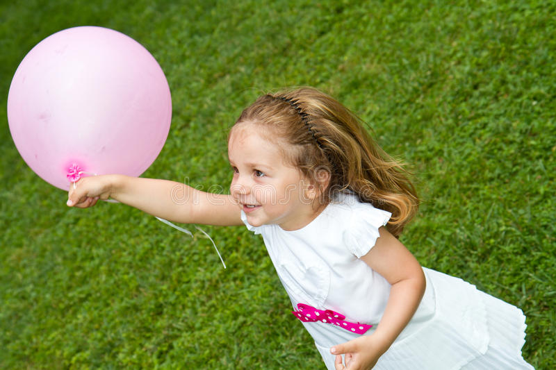 Little girl playing. With balloon royalty free stock photography