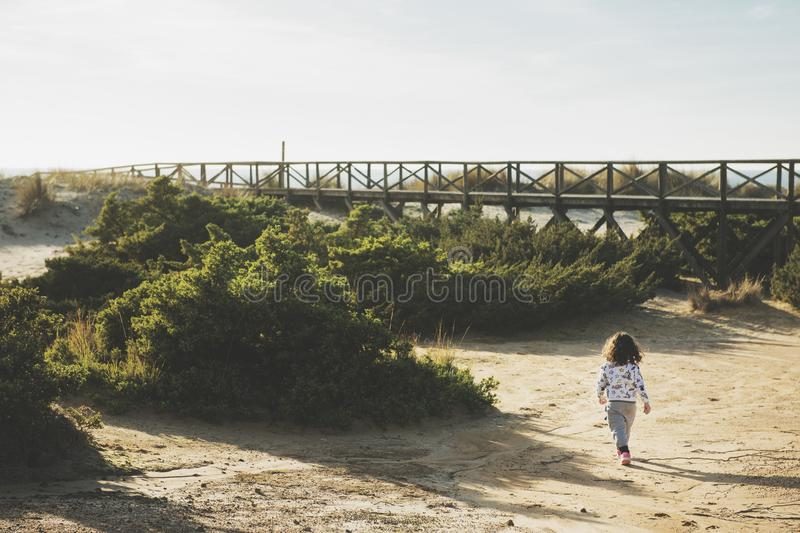 Little girl playing adventures in nature stock photography