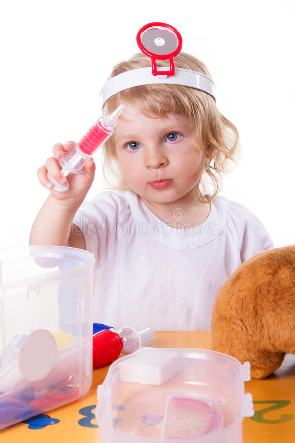 Little girl playing as doctor stock photo