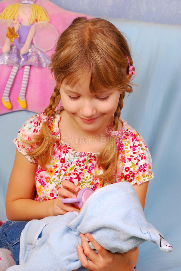 Download Little Girl Playing With Baby Doll Stock Image - Image of plaits, preschool: 13160369