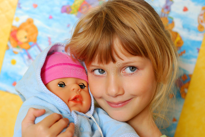 Download Little Girl Playing With Baby Doll Stock Photo - Image: 13160602