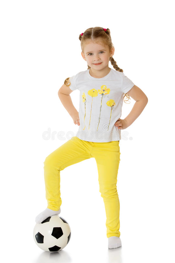 Little girl playing with a ball stock image