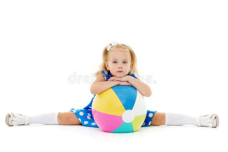 Little girl is playing with a ball stock photography