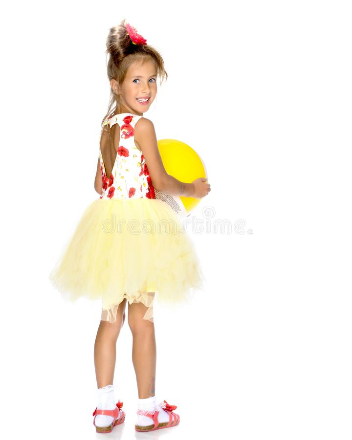 Little girl is playing with a ball royalty free stock image