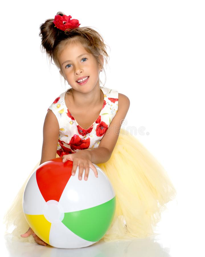 Little girl is playing with a ball royalty free stock images