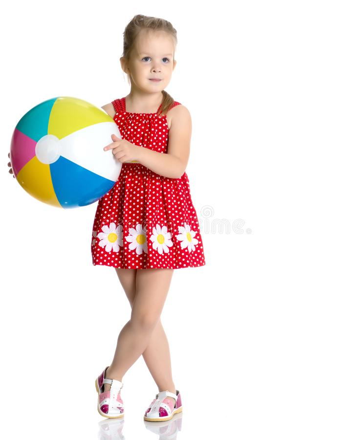 Little girl is playing with a ball stock image