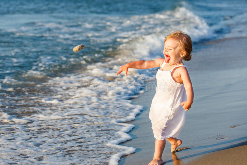 Download Little Girl Playing On The Beach Stock Image - Image of face, child: 25598767