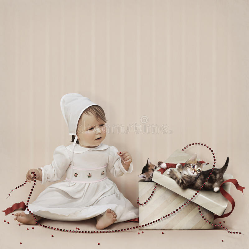 Download Little Girl Playing With Beads And Kittens In A Gi Stock Photo - Image: 17018460
