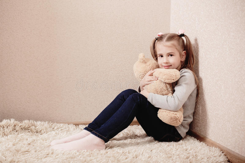 little girl playing with bear stock images