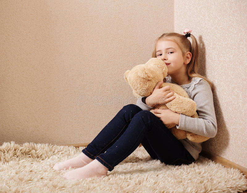 little girl playing with bear stock photography