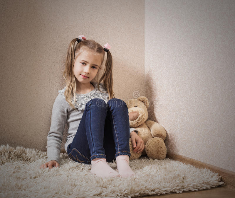 little girl playing with bear royalty free stock photo