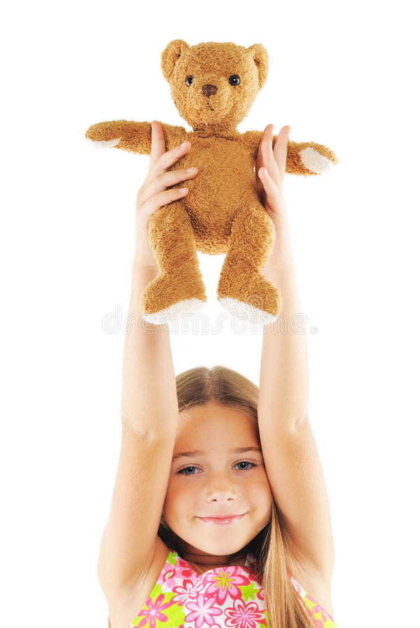 Little girl playing with bear toy. Little girl with bear toy. On white background royalty free stock image